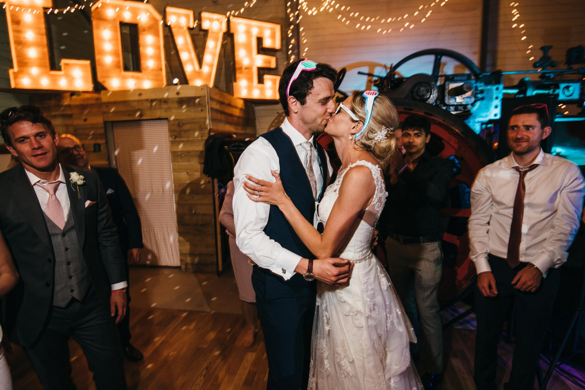 Bride and groom kiss Froginwell devon