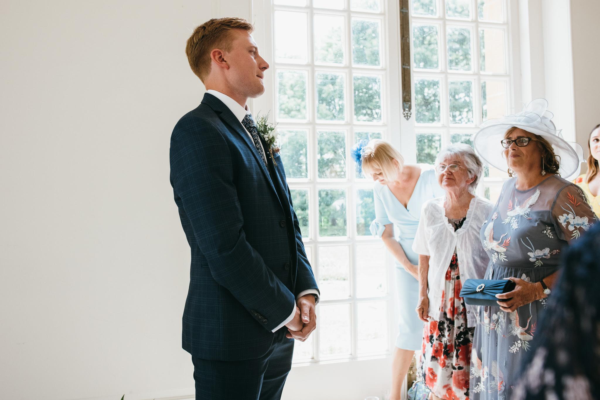 Groom waits for bride Hestercombe gardens