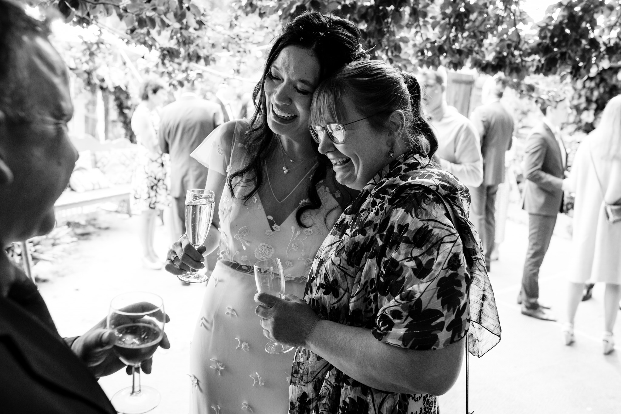 The dreys kent wedding bride hugs guest, reception photography
