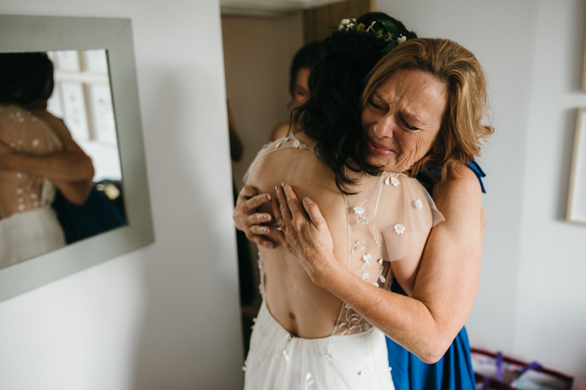 Bride hugs her mum