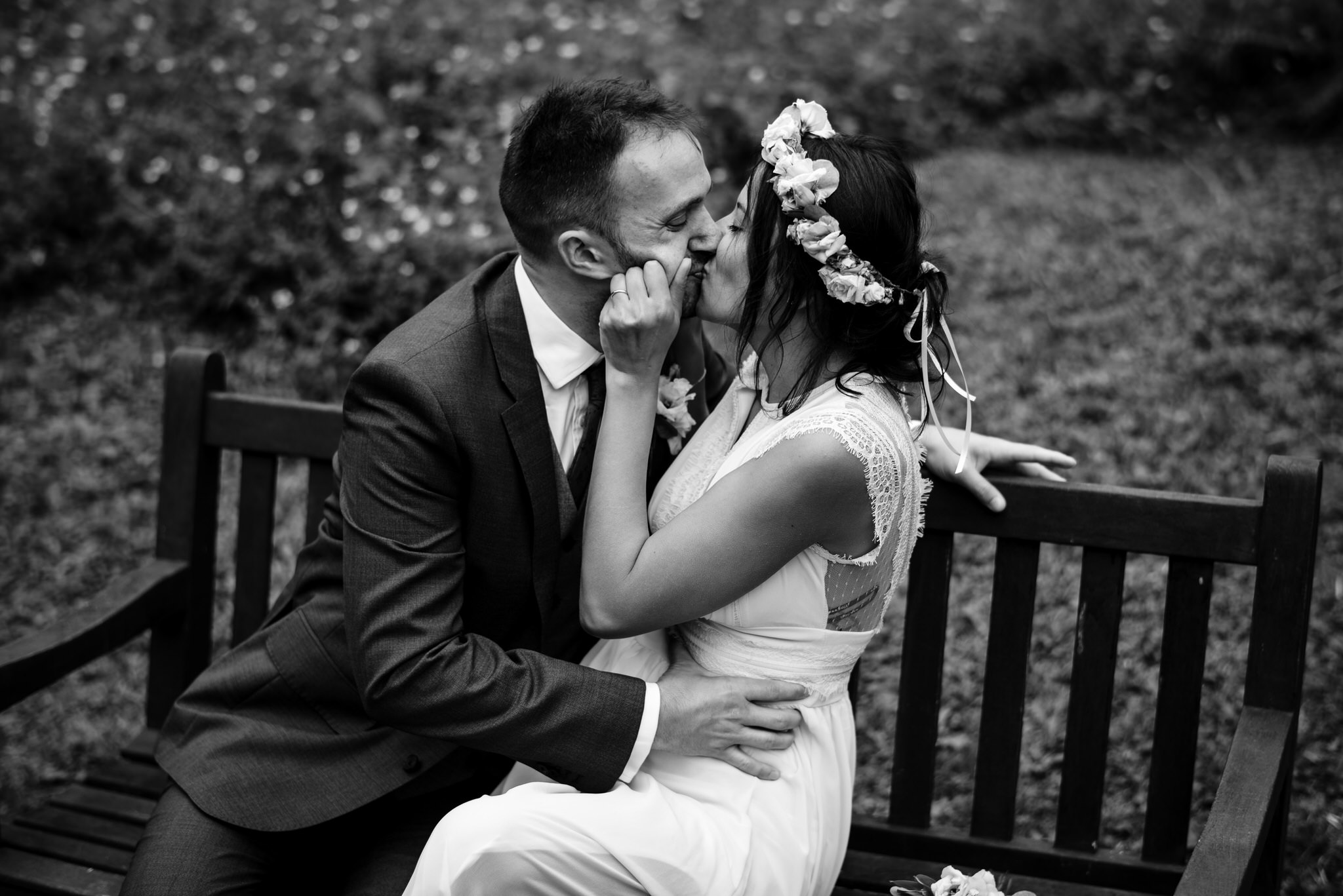 Bride and groom kiss on bench, Botanical Gardens, Victoria Park