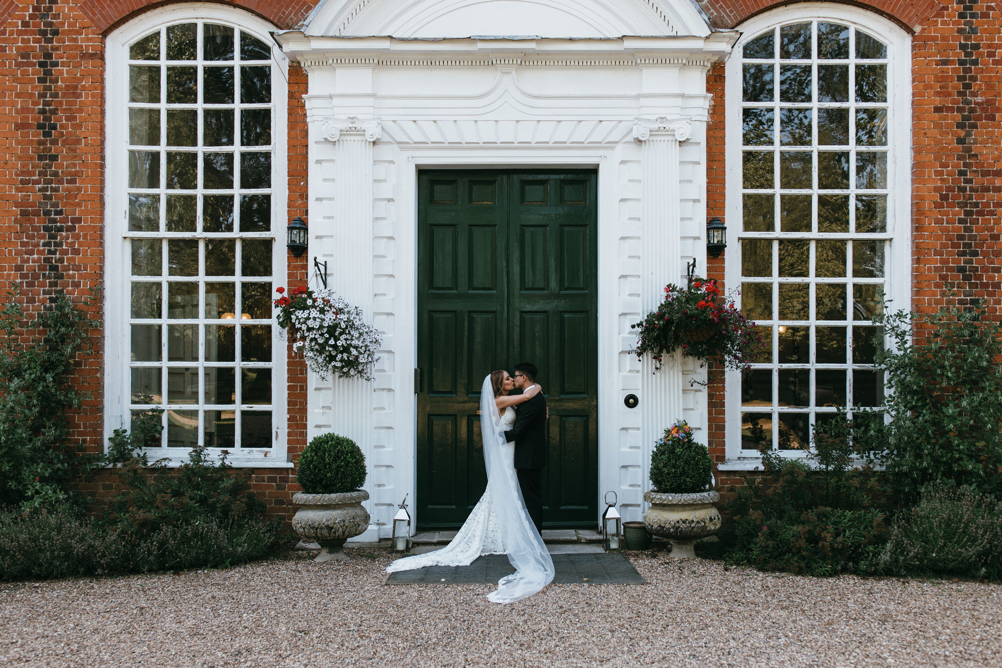 Bride and groom outside Gosfield Hall