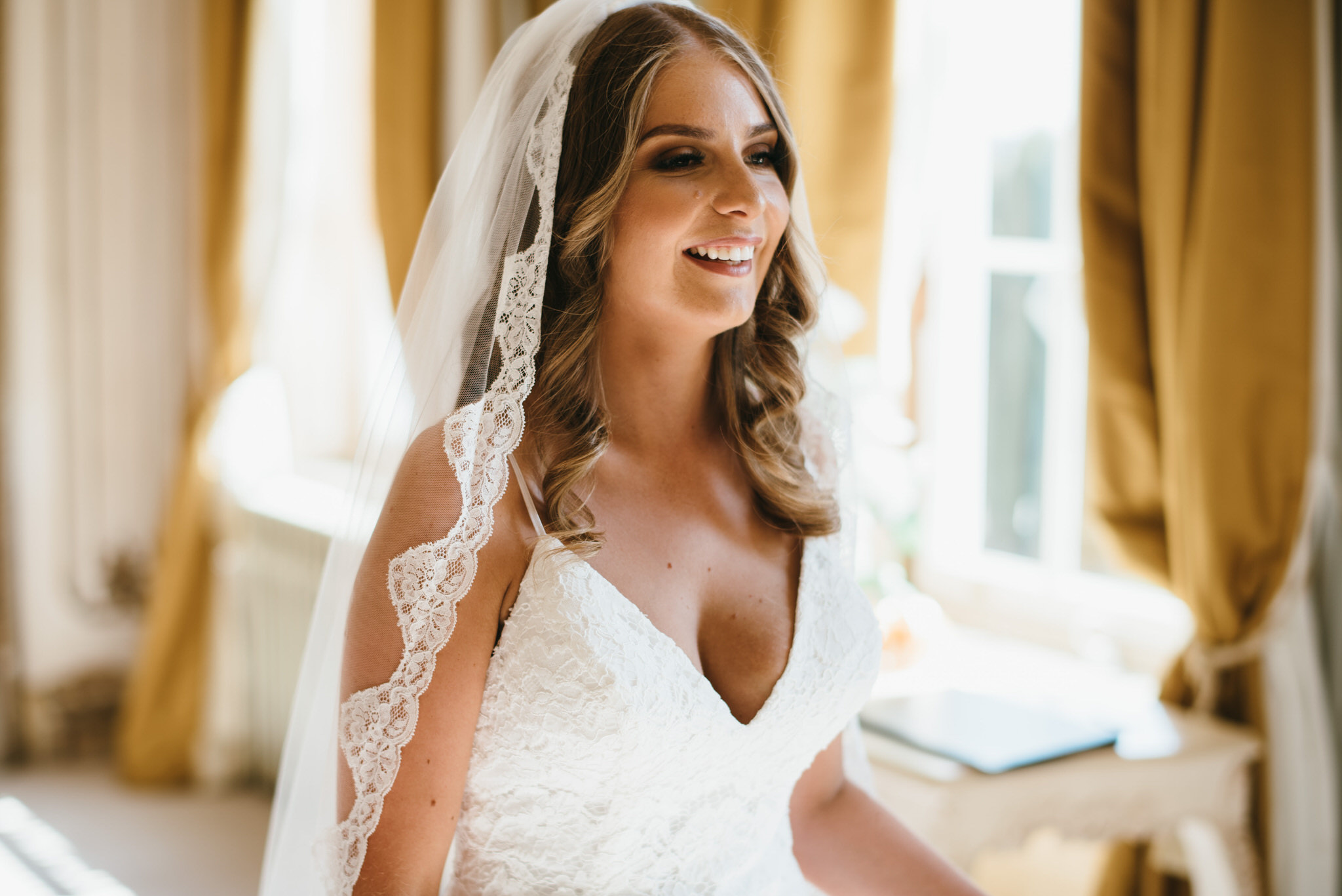 Bride looking happy at Gosfield Hall