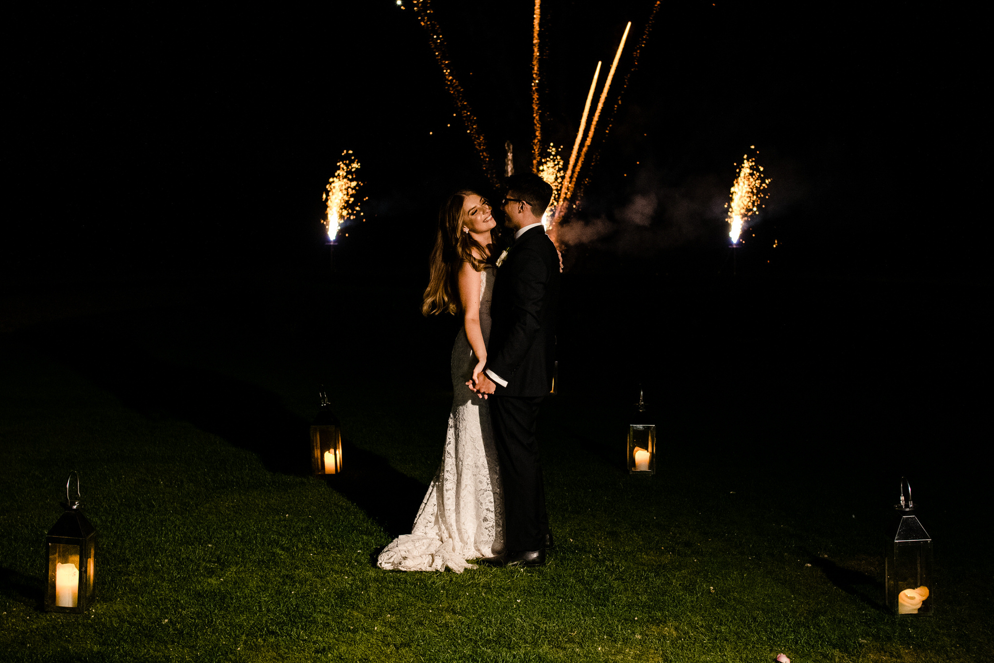 Bride and groom during fireworks at Gosfield Hall