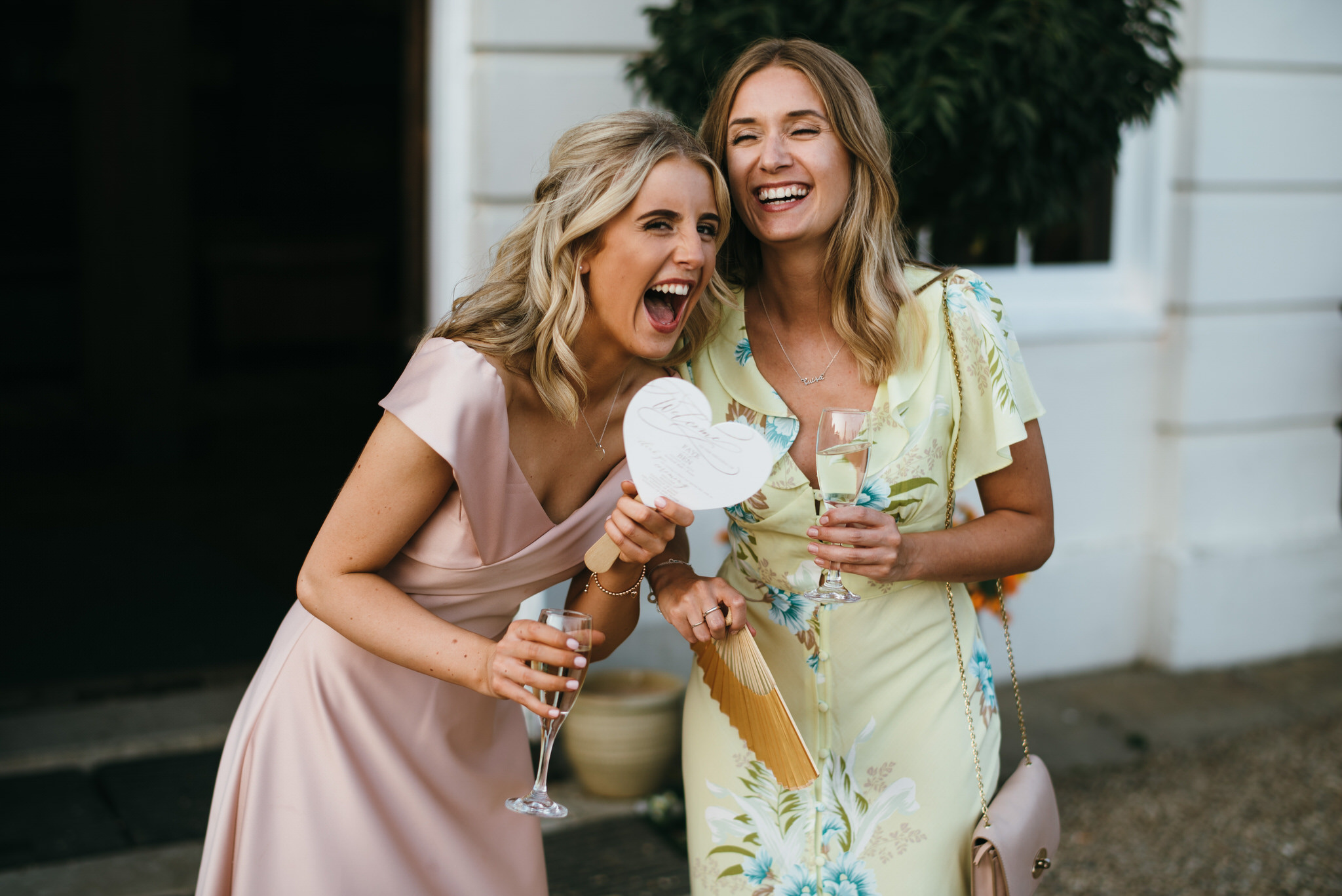 Girls laughing at Gosfield Hall wedding