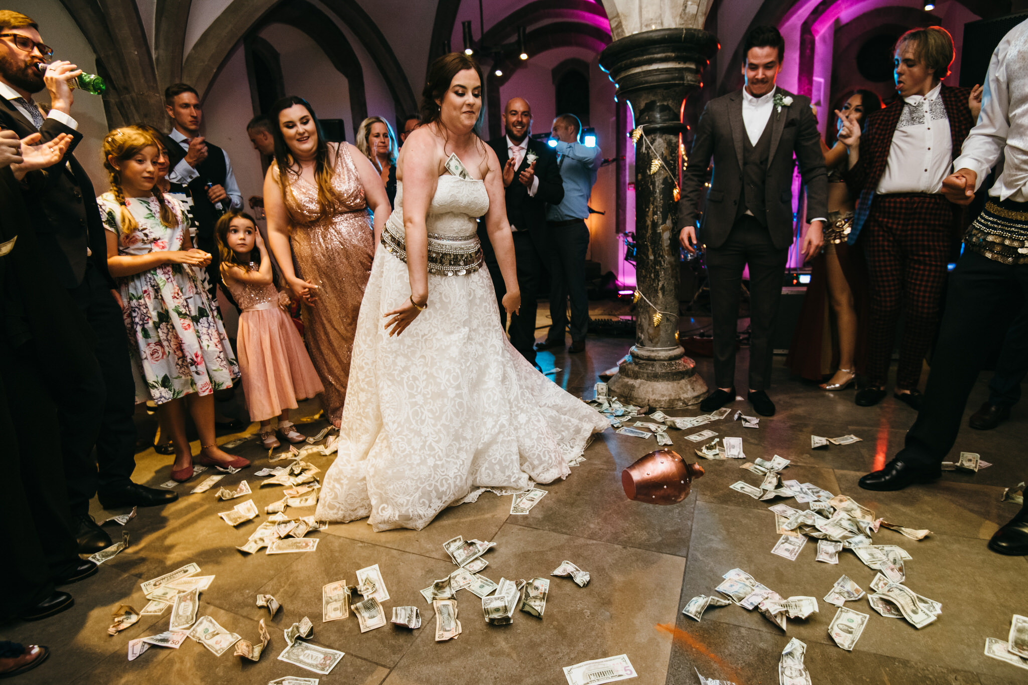 Bride smashes jar in Cypriot tradition during wedding at Bishops Palace