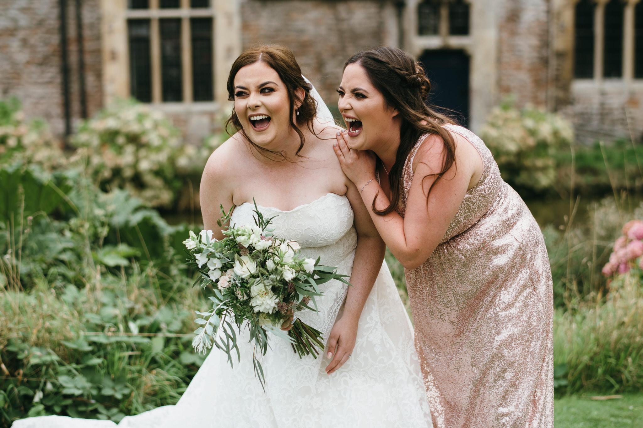 Bride and bridesmaids laughing at Bishops Palace