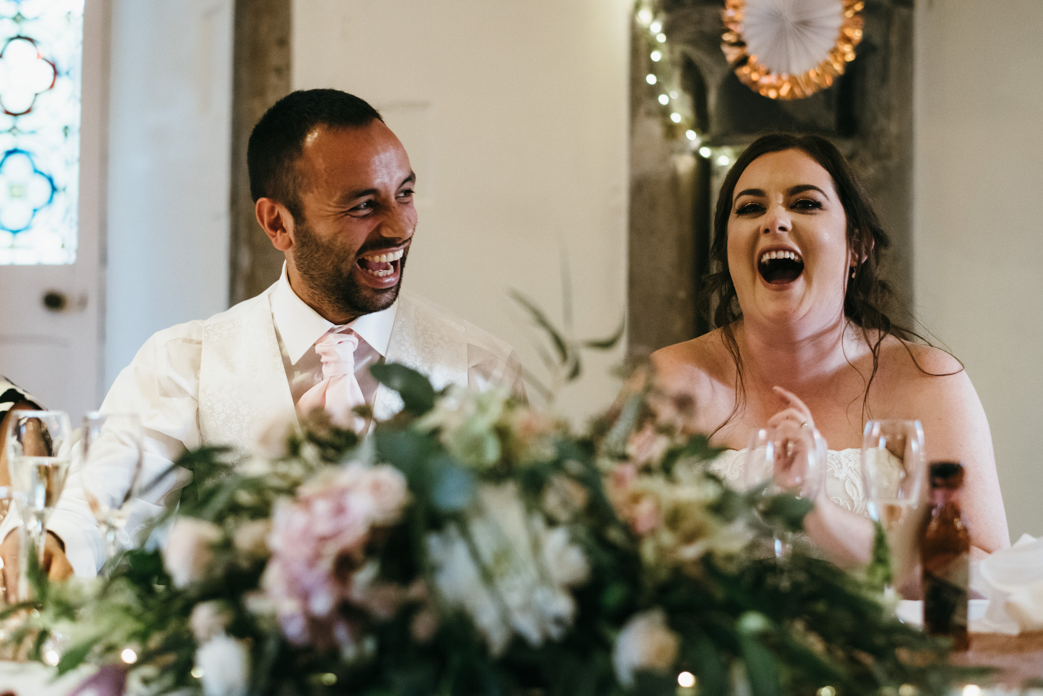 Couple laugh during speeches at The Bishops palace