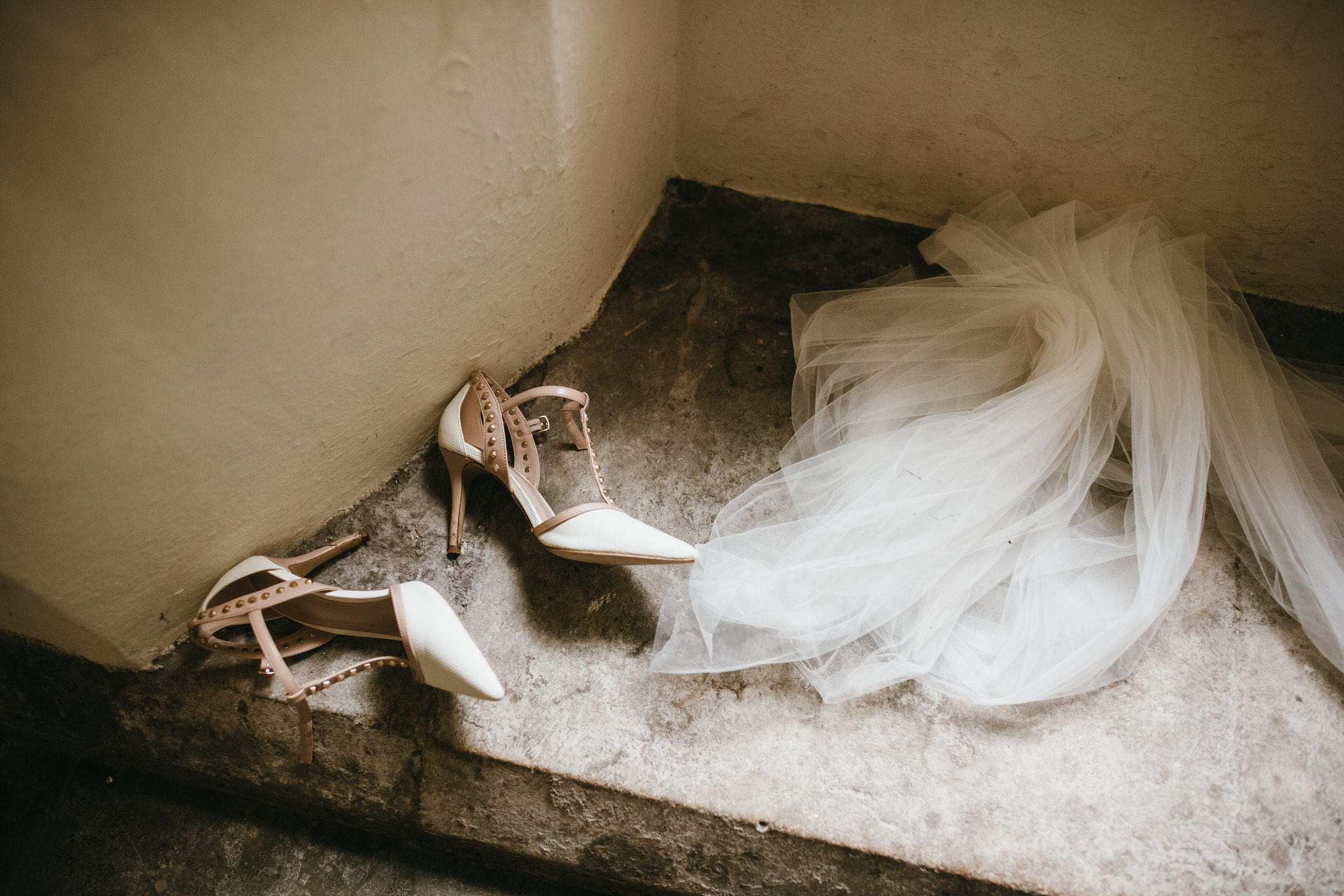 Brides shoes and veils on window sill Bishops Palace