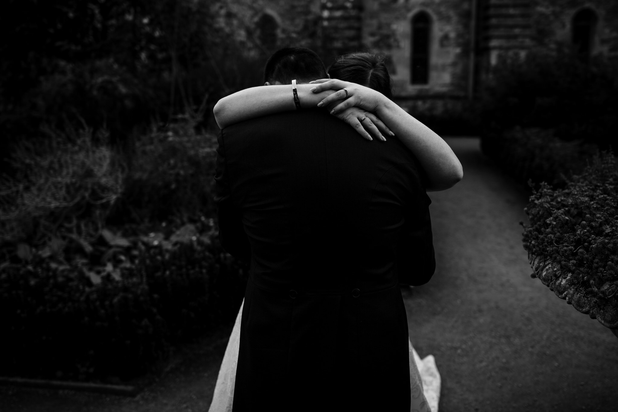 Bride and groom romantic embrace at Bishops Palace Wells