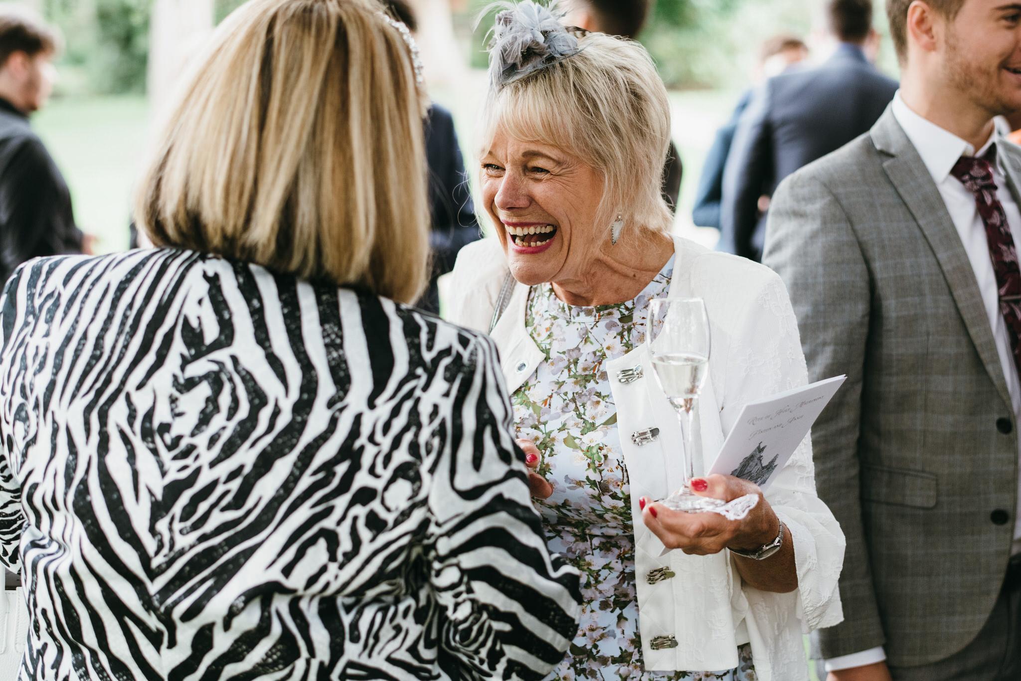 Candid shot of guests at Bishops palace wedding