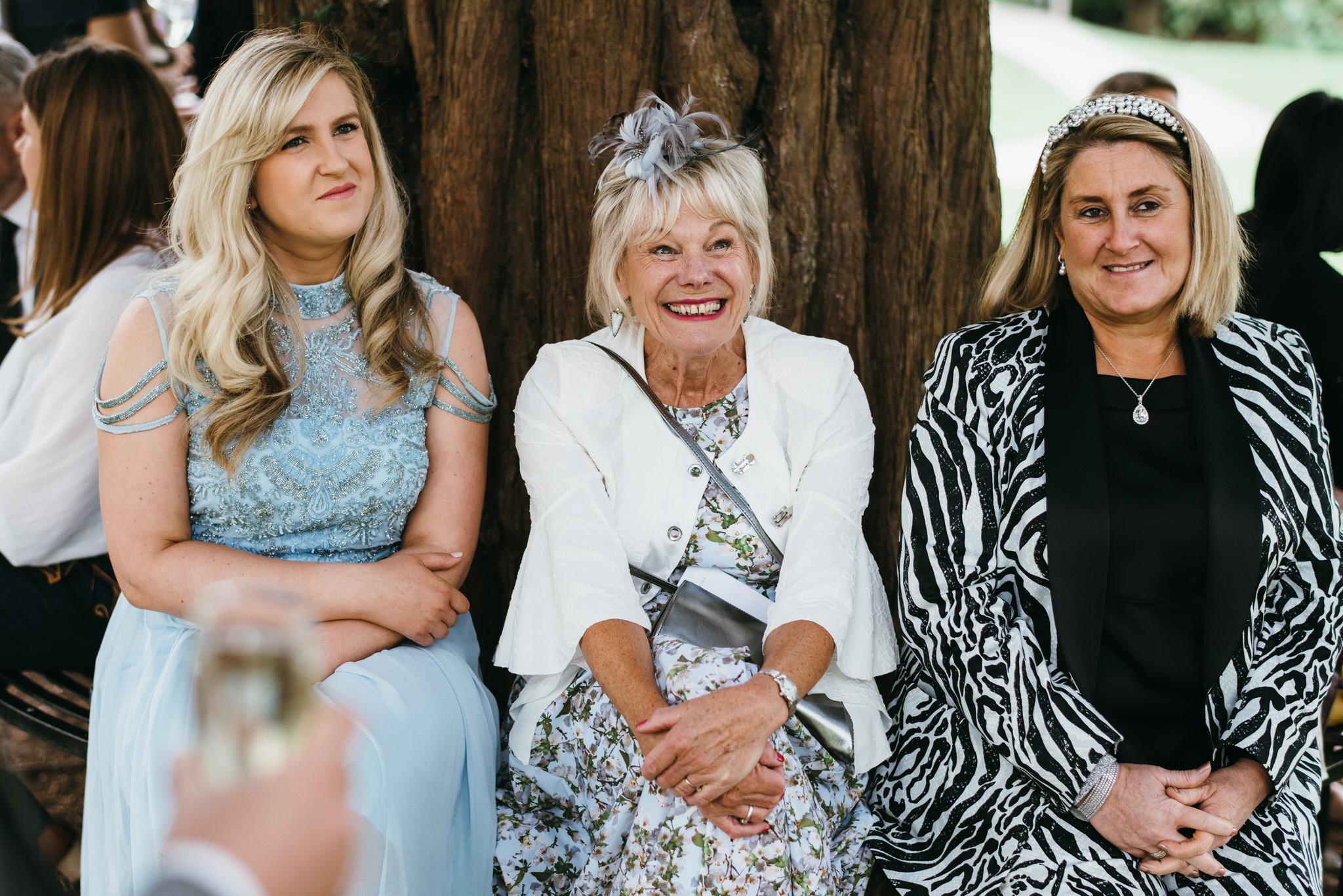 Guest smiling at Bishops palace wedding