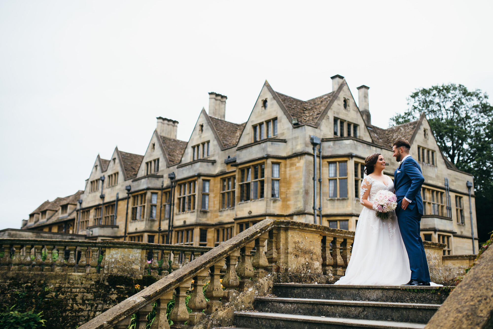 bride and groom by Coombe lodge wedding venue
