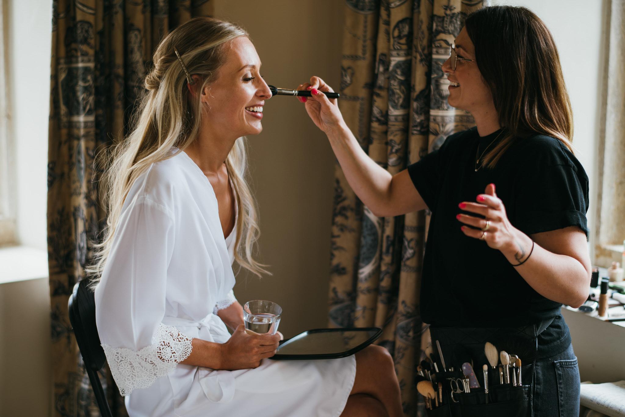 Byannabella applying makeup to bride