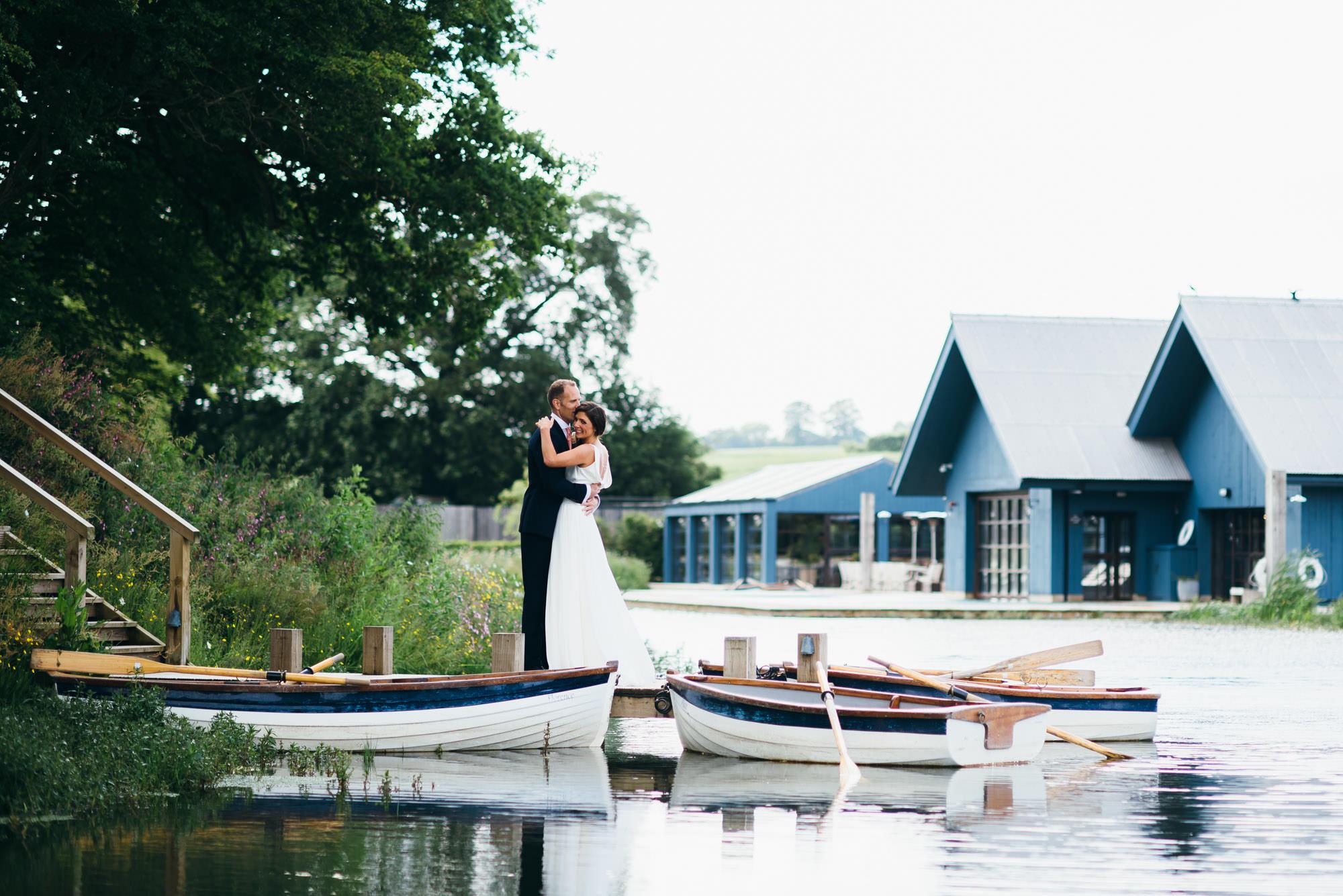Soho farmhouse wedding couple on dock