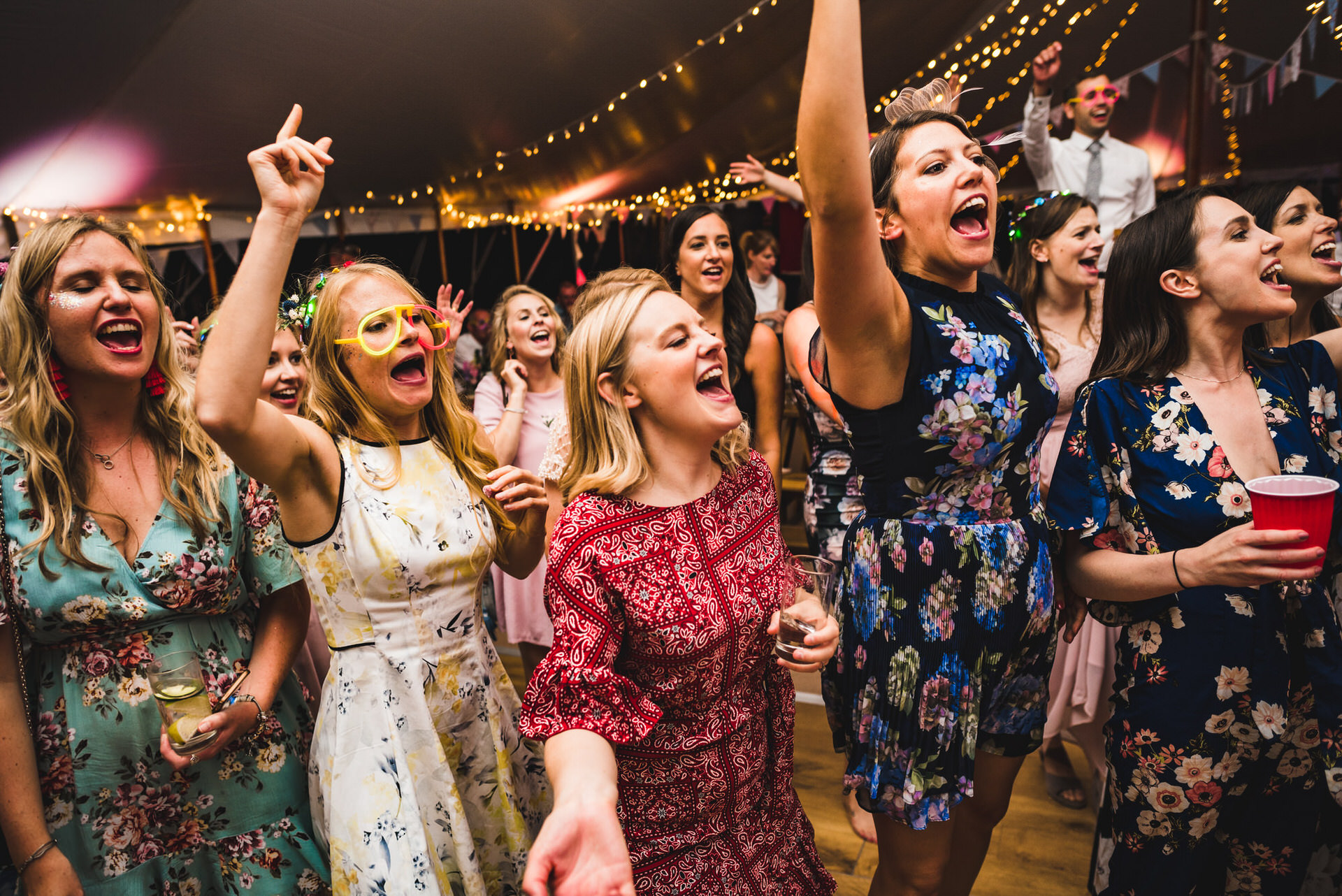 wedding guests sing along to band