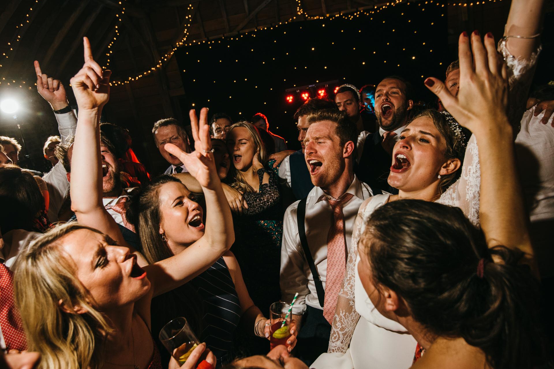 Guests dancing to band at wedding