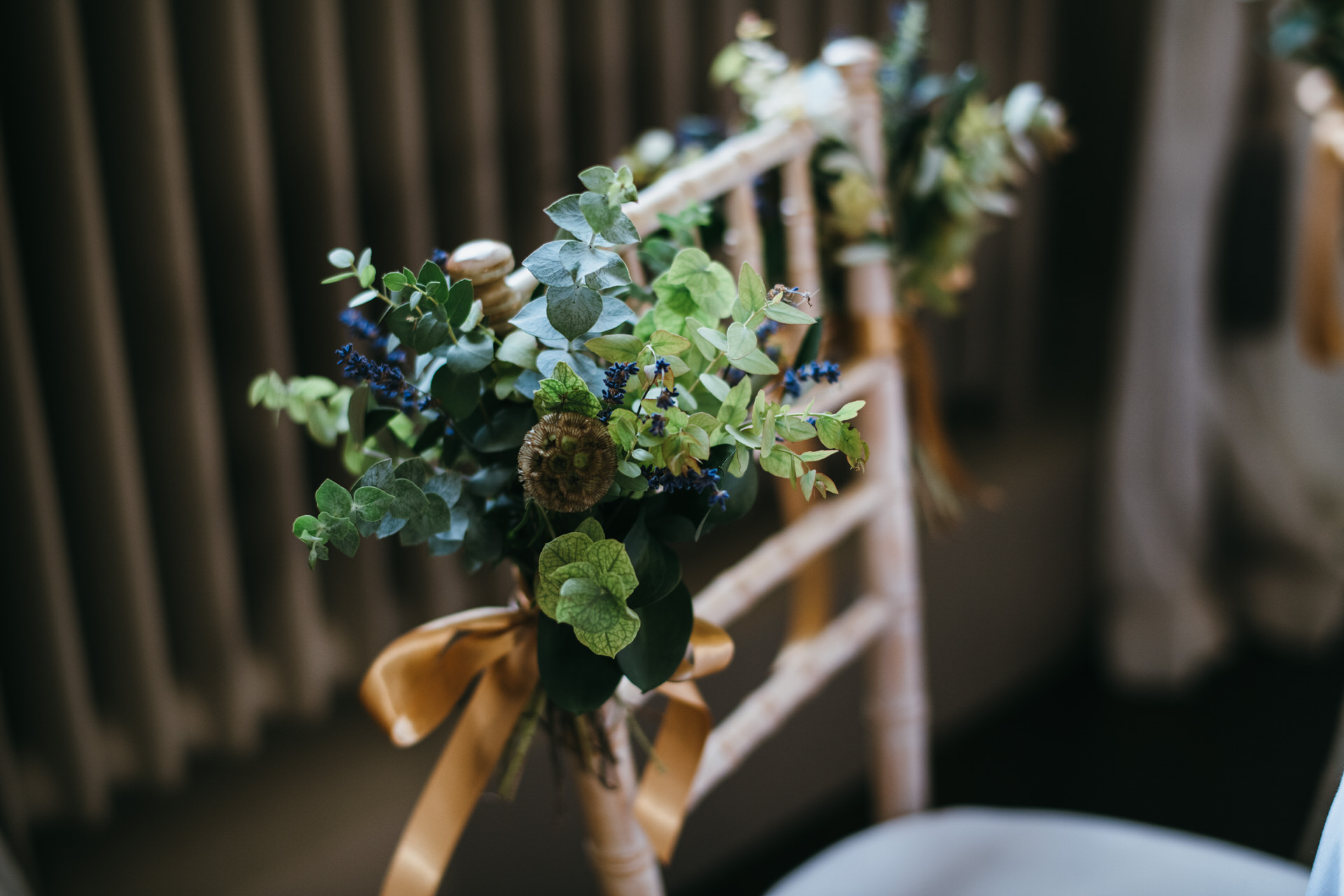 Flowers on wedding chairs