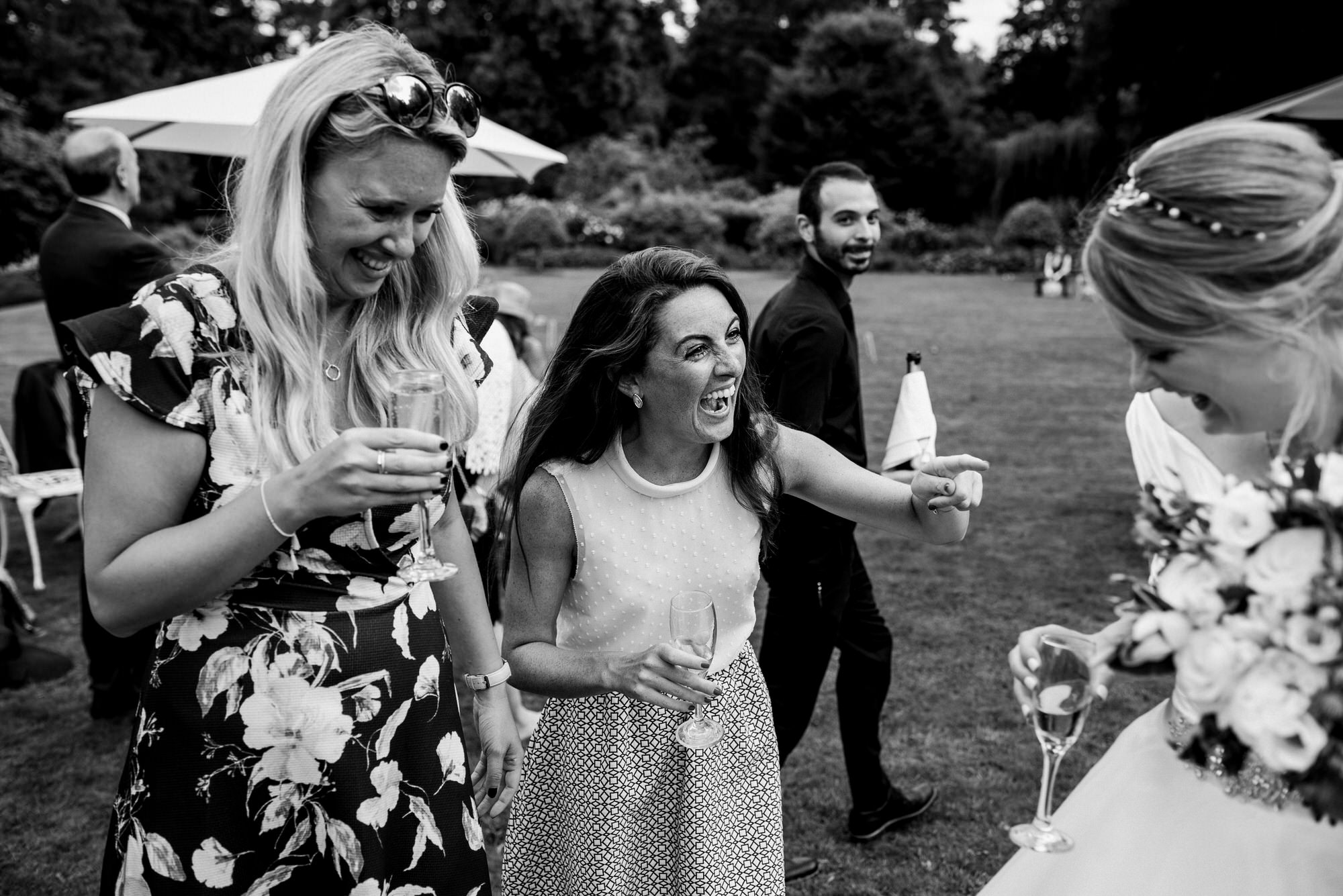 Friends laugh with bride