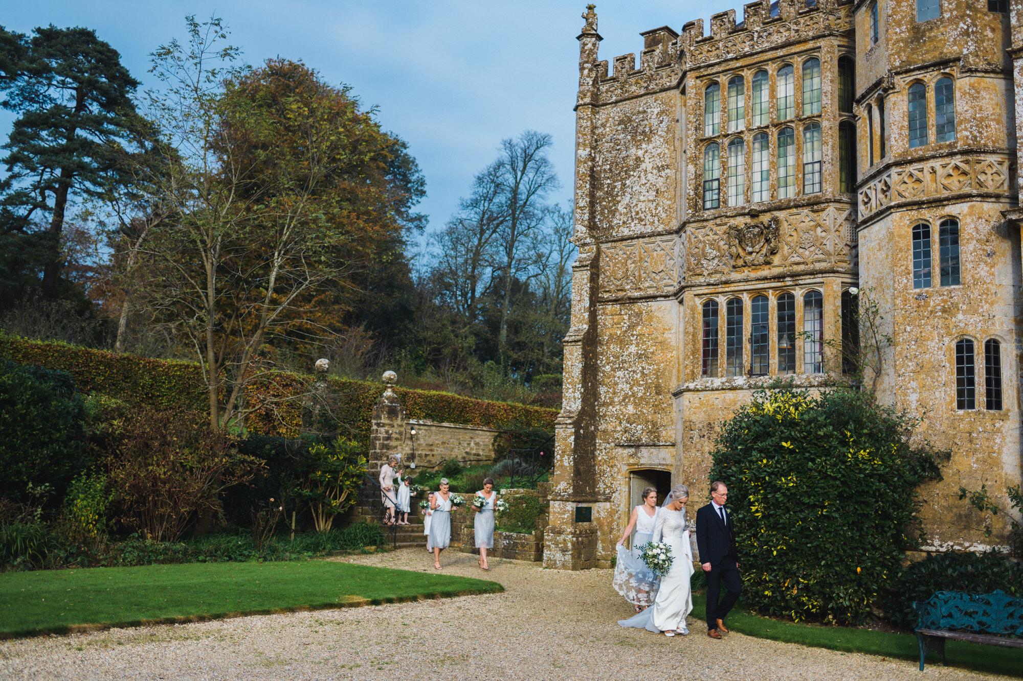 Brympton wedding bride walking to ceremony by simon biffen photography 16
