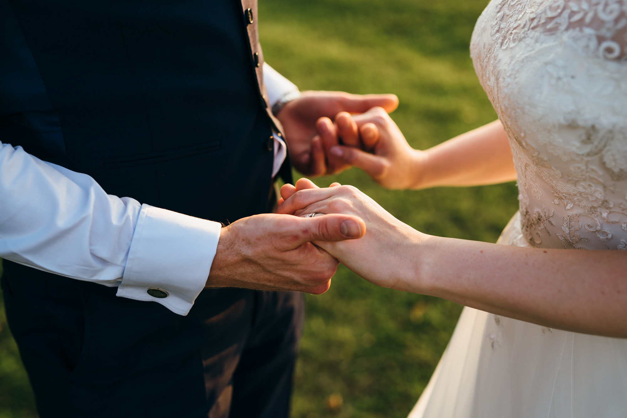 Bride and groom hands Colville hall wedding