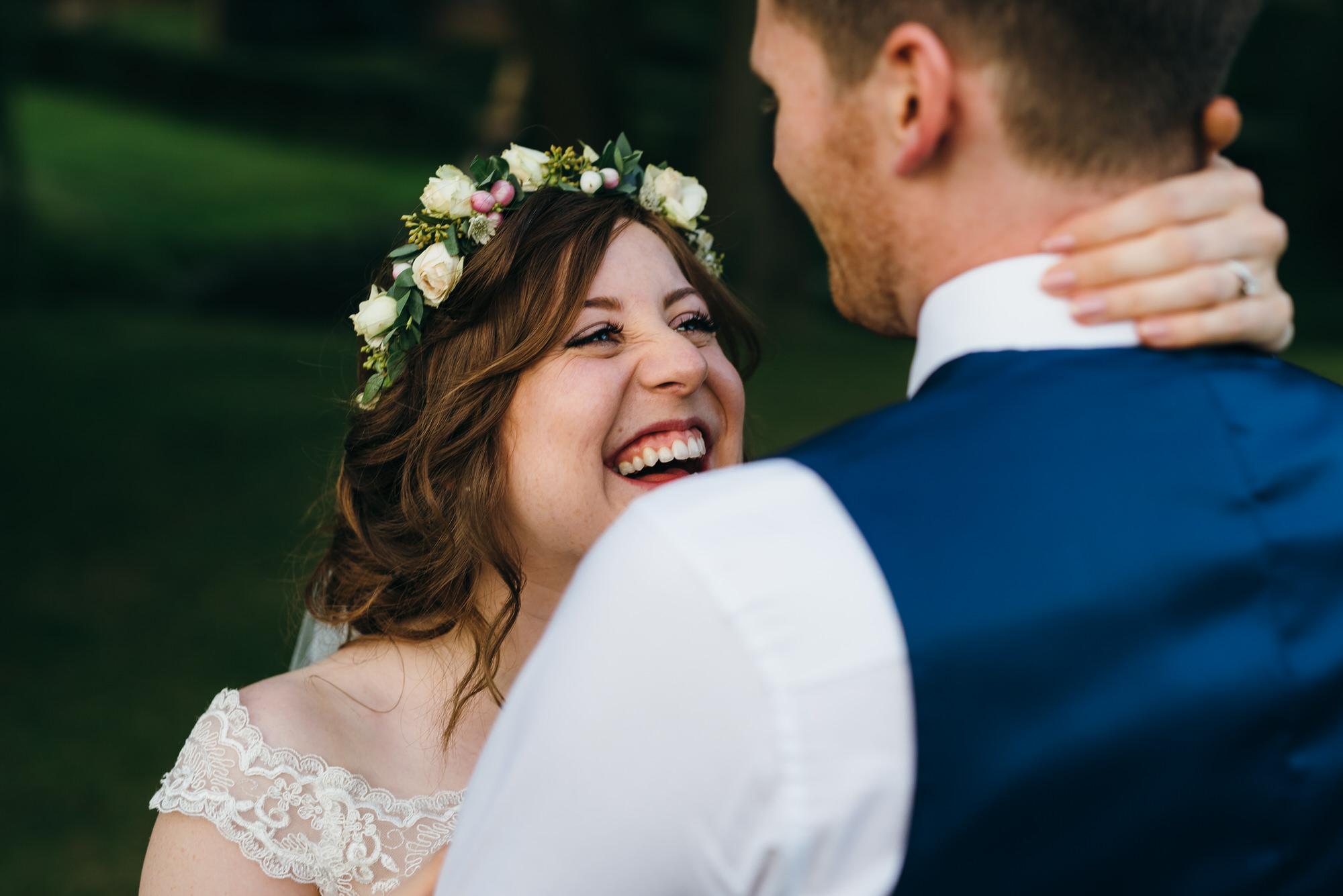 Bride looks at groom Colville hall