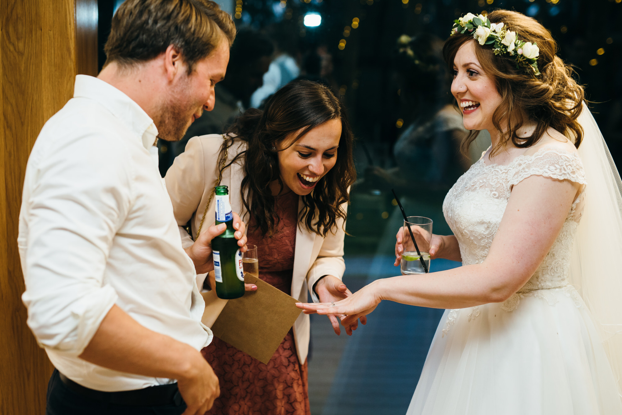 Bride shows ring at Colville hall wedding