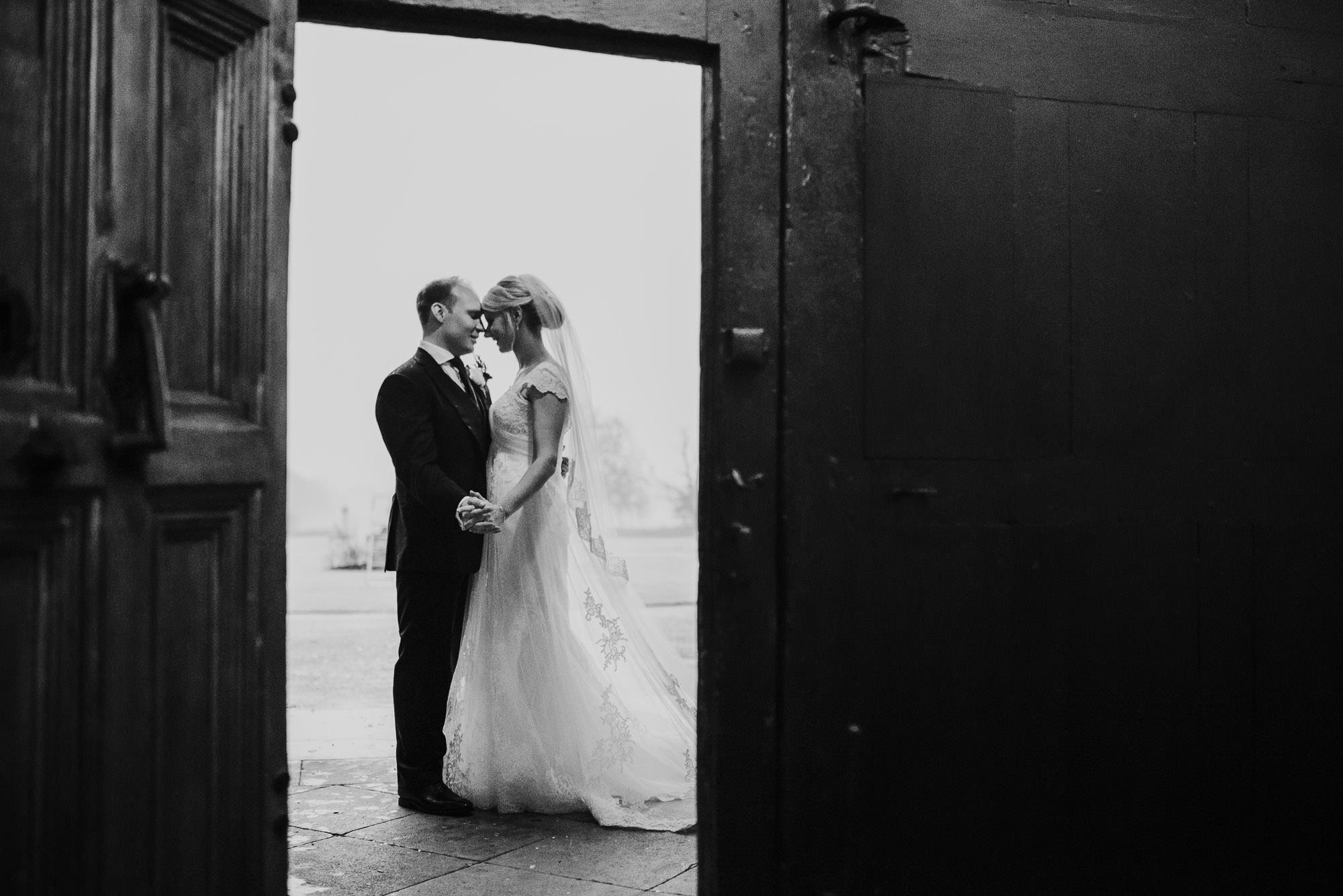 Unposed Hengrave hall wedding photographer