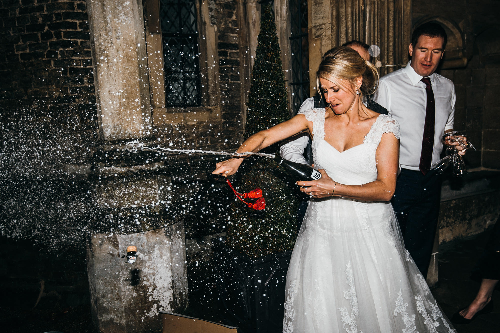 Bride pops champagne at Hengrave Hall