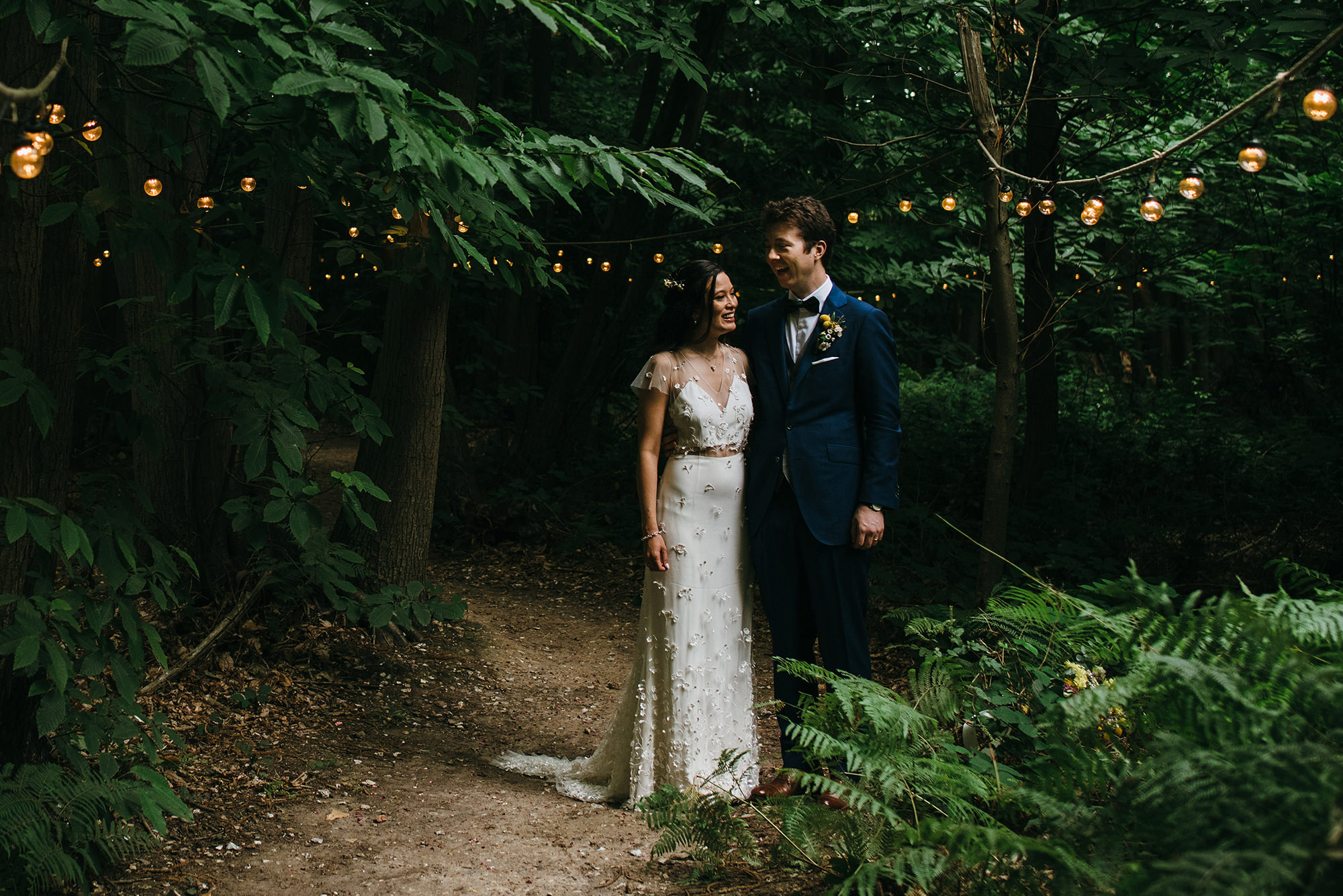 Bride and groom together in woods