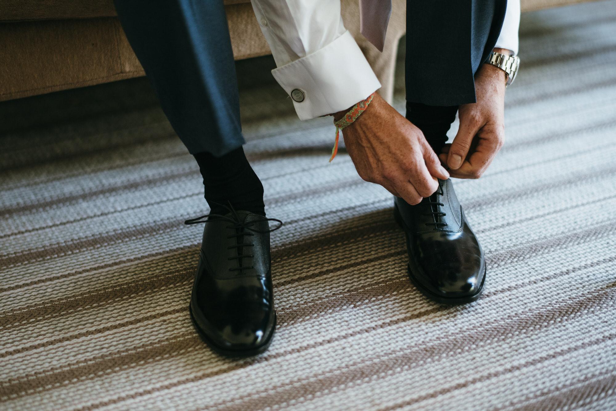 Groom ties shoelaces