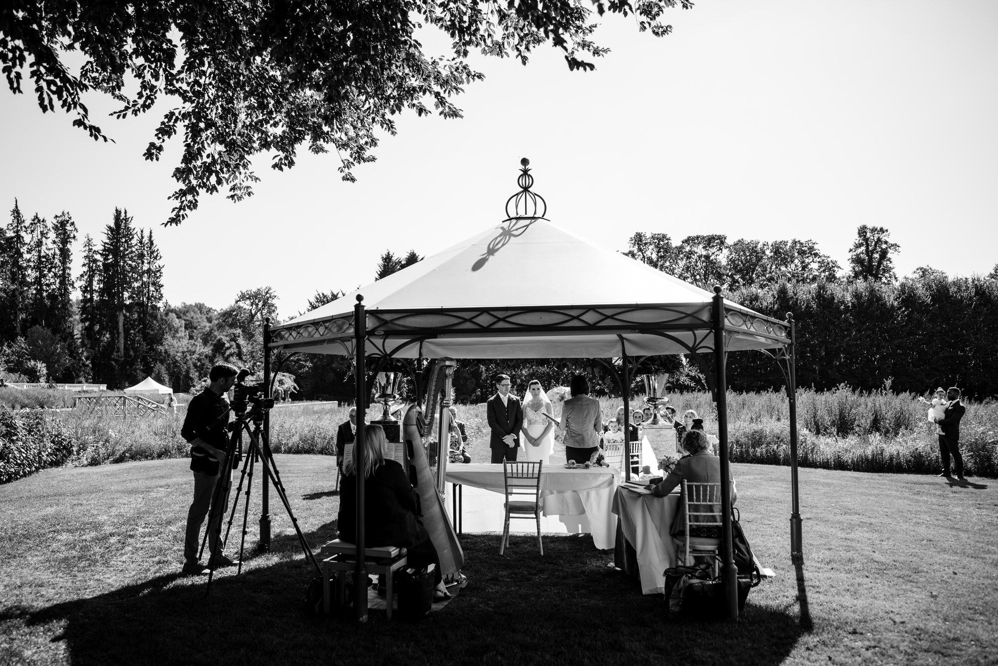 wedding in wildflower meadow Coworth Park