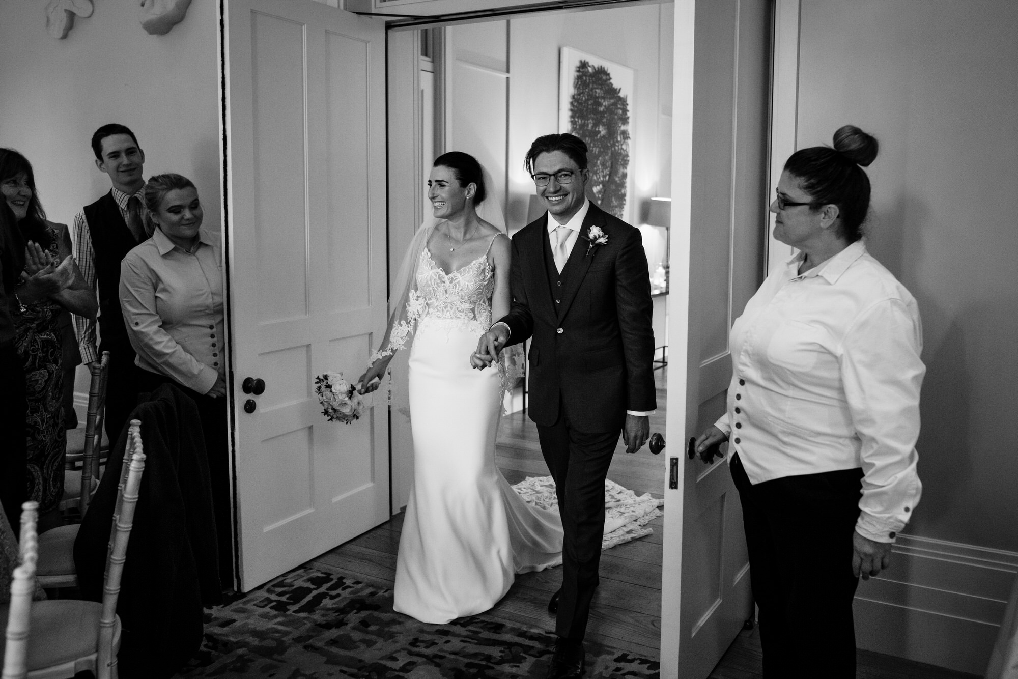 Bride and groom enter the room