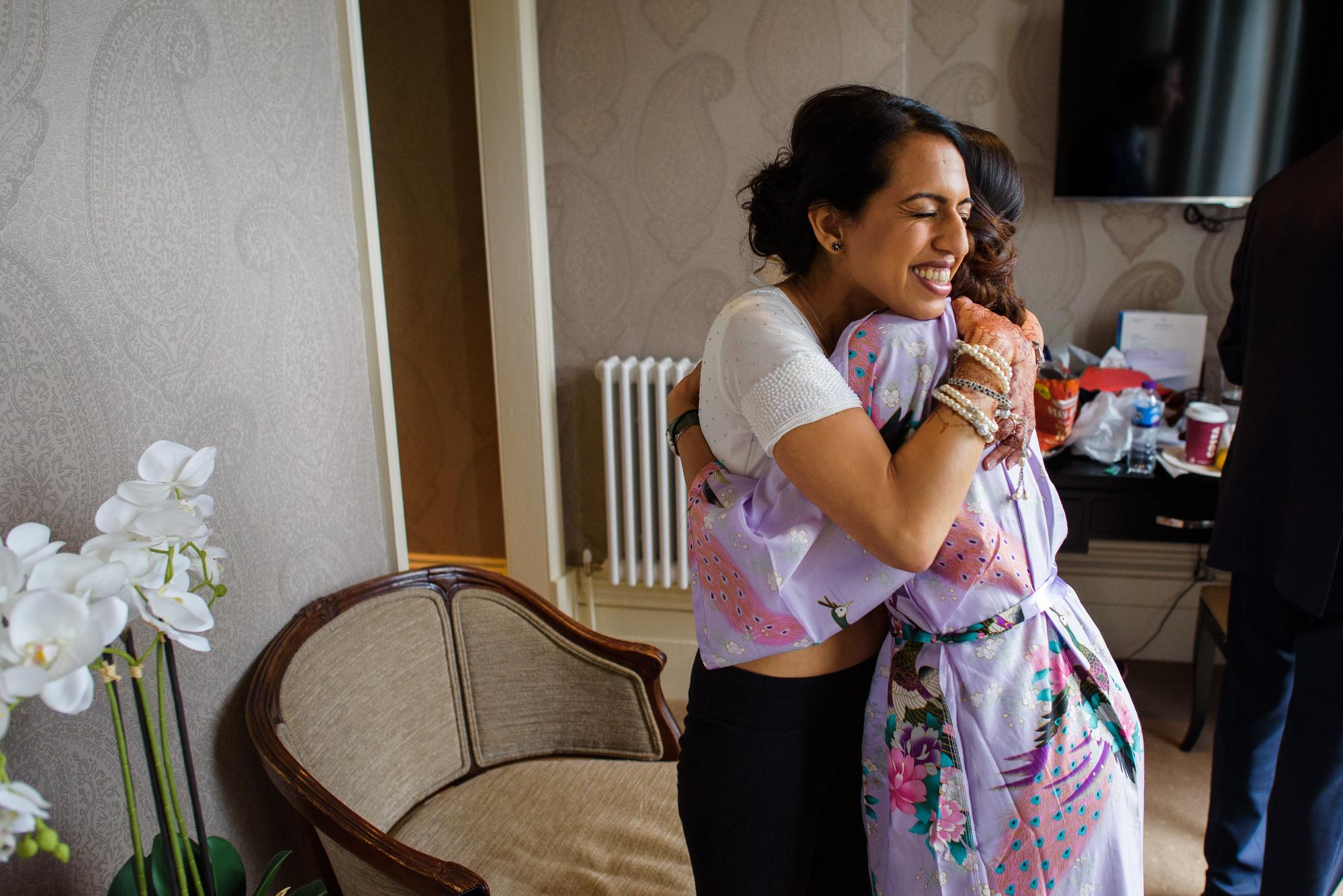 Bride hugs friend