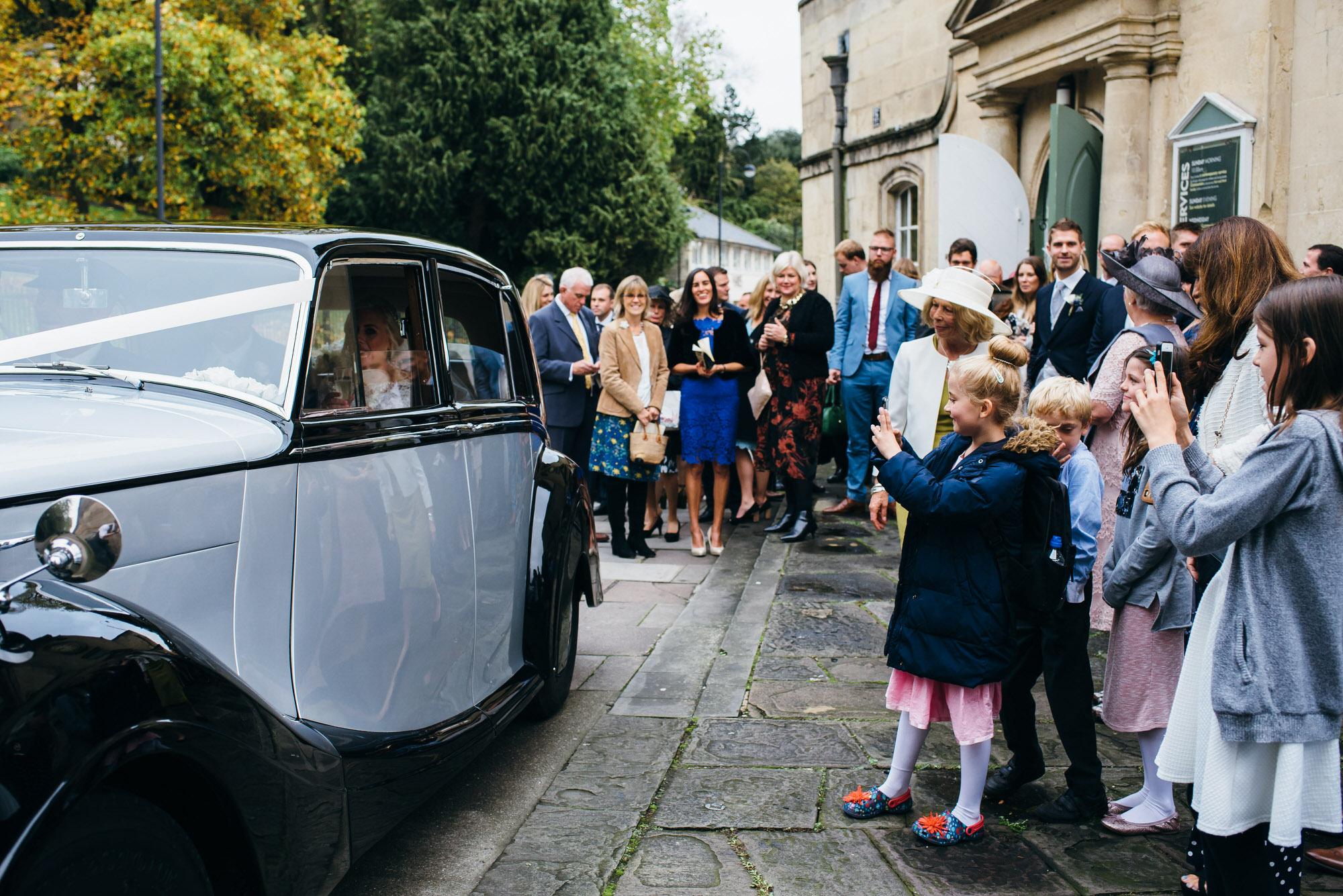 Newlyweds depart in car